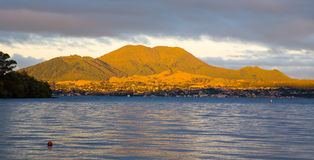 Taupo, North Island, New Zealand. Evening light on Mountains Behind Taupo viewed from Acacia Bay, North Island, New Zealand stock photos