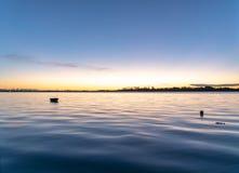 Tauranga Harbour Sunrise Glow Across Water At Dawn. Stock Image