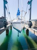 Tauranga Marina hardstand travel lift with yacht hoisted for mai. Ntenance Stock Images