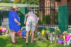 People laying memorial flowers at Tauranga mosque after Christchurch mosque attacks. Tauranga, New Zealand - March 16 2019: Tauranga locals lay flowers outside royalty free stock images