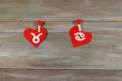 Taurus and cancer. signs of the zodiac and heart. felt. wooden b. Ackground. card. Love. unusual handwork stock photo