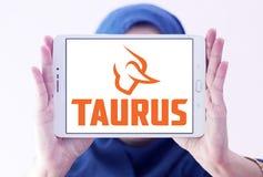 Taurus firearms manufacturer logo. Logo of Taurus firearms manufacturer on samsung tablet holded by arab muslim woman. Forjas Taurus manufacturing firearms Royalty Free Stock Images