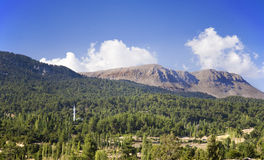 Taurus Mountains, Turkey. Scenic view of a region of the Taurus Mountains, Turkey with mosque standing amongst trees royalty free stock images