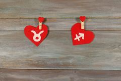 Taurus and Sagittarius. signs of the zodiac and heart. wooden ba. Taurus and Sagittarius. signs of the zodiac and  heart. wooden background. card. Love. unusual Royalty Free Stock Images