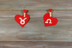 Taurus and scales. signs of the zodiac and heart. wooden backgro. Und. card. Love. unusual handwork stock photography