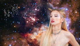 Taurus Zodiac Sign. Astrology and horoscope. Beautiful woman Taurus on the galaxy background. Taurus Zodiac Sign. Astrology and horoscope concept. Beautiful royalty free stock image