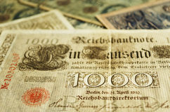 Tausend Mark. Part of an old German banknote from 1910. Other old banknotes can be seen blurred in the background Stock Image