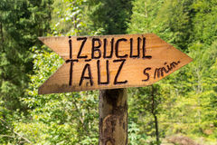 Tauz karst spring direction sign. In Aries Valley, Romania stock image