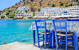 Tavern. Greek tavern on near the sea with blue chairs Stock Photography