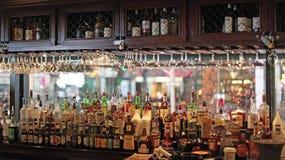 Tavern, Pub, Restaurant Bar. Pub, tavern, restaurant bar filled with alcoholic bottles royalty free stock image
