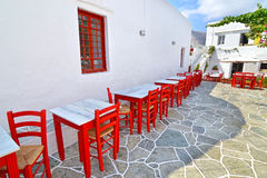 Tavern with red chair and tables Sifnos Greece stock photos