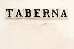 Tavern sign in Spanish. Tavern sign on old Spanish house in downtown Cordoba, Spain Stock Photo