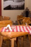 Tavern wooden table in the focus Royalty Free Stock Photo