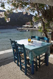 Taverna's table and chairs. Assos, Kefalonia, Greece Royalty Free Stock Image