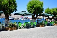 Tavernas портового района на острове Греции Leros Стоковая Фотография RF