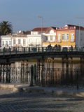 Tavira near the river, with bridge crossing. Tavira downtown small houses, near the Sequa river Royalty Free Stock Image