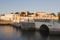 Tavira, Portugal, Algarve - old roman bridge. Early in the morning royalty free stock image
