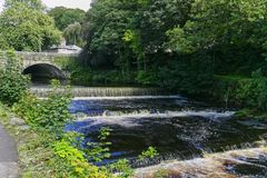 Tavistock Bridge and river Tavy. Over Weir, situated in Devon UK royalty free stock photography