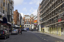 Tavistock street in London at day time. LONDON, UNITED KINGDOM - SEPTEMBER 12 2015: Tavistock street in London at day time, with scaffoldings  on the left side Stock Images