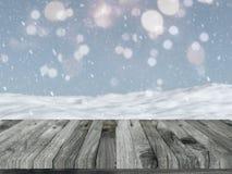 Tavola di legno con paesaggio nevoso defocussed Immagine Stock Libera da Diritti