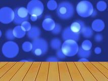Tavola di legno della plancia di Brown davanti al fondo blu scuro del bokeh immagini stock