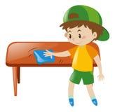 Tavola di pulizia del ragazzino con il panno Fotografia Stock