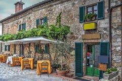Tavole del ristorante in Moteriggioni Immagine Stock