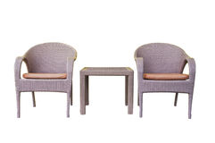 Tavole e sedie dei rattan messe Immagini Stock