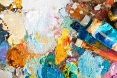 Tavolozza con olio e la spazzola immagini stock libere da diritti