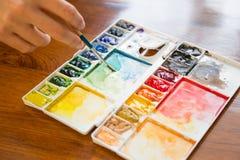 Tavolozza della pittura e del pennello Fotografie Stock