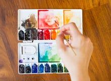 Tavolozza della pittura e del pennello Immagine Stock