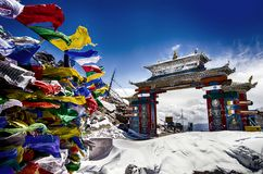 Tawang, Arunachal Pradesh. India. The Buddhist architecture, prayer flags and full of snow on a misty morning at , North East India Stock Image