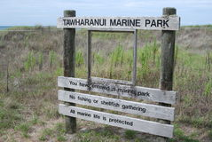 Tawharanui Marine Park sign Stock Image