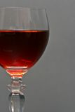Tawny Port. A glass of tawny port on a gray background Stock Photos