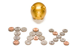 Tax. Golden piggy bank standing in front of TAX spelled out in coins royalty free stock images