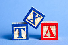 Tax. Alphabet blue and red blocks TAX Royalty Free Stock Images