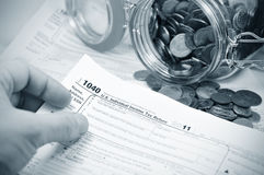 Tax. Forms and a jar of coins royalty free stock photography