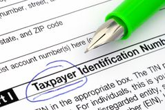 Tax. Payer declaration form and a pen Royalty Free Stock Photo