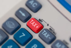 Tax. Close up macro shot of calculator with tax button royalty free stock photo