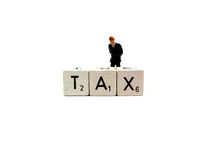 Tax. A businessman is getting worried because of the tax he has to pay royalty free stock image
