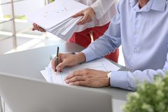Tax accountants working with documents stock images