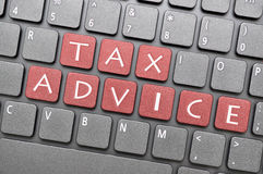 Tax advice on keyboard Stock Photography