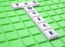 Tax advise. This is an image of letter blocks Stock Photo