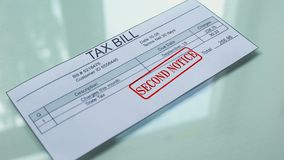 Tax bill second notice, hand stamping seal on document, payment for services. Stock footage stock video