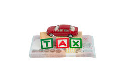 Tax block and car on money Stock Photography