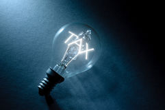 Tax. Bulb with tax light inside stock photos