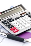 Tax calculator and pen. Calculating numbers for income tax return with pen and calculator Stock Image
