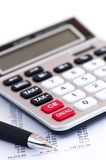 Tax calculator and pen. Calculating numbers for income tax return with pen and calculator Stock Photo