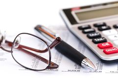 Tax calculator pen and glasses. Calculating numbers for income tax return with glasses pen and calculator Royalty Free Stock Photo