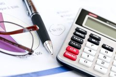 Tax calculator pen and glasses Stock Photography